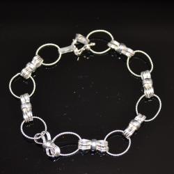 Zilveren armband  Strikjes